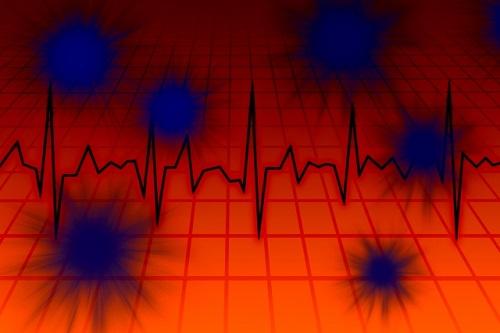 赤い背景に青いウイルスのイメージ